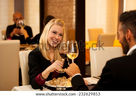 Young people eat dinner at restaurant