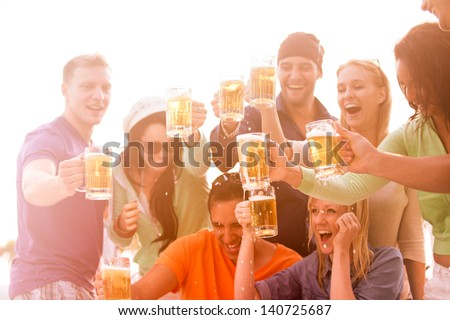 Young People in their twenties on the Venice Beach boardwalk in California drinking beer
