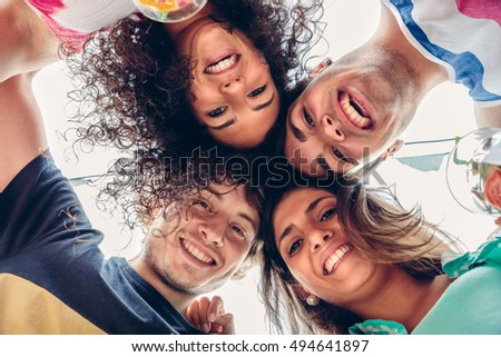 Young people with their heads together having fun