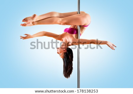 Young pole dance woman. Bright blue colors.