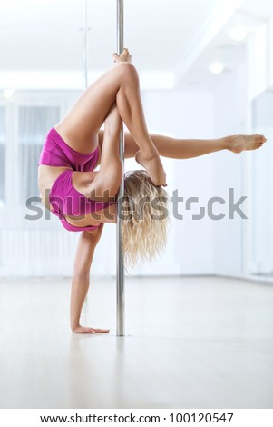 Young pole dance woman. Bright white colors.