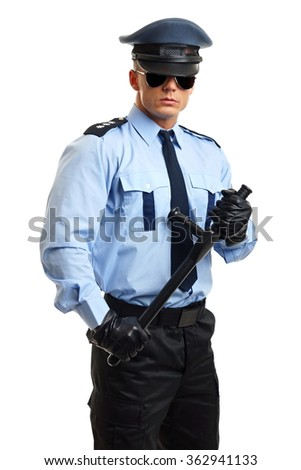 Young policeman in uniform holds police nightstick