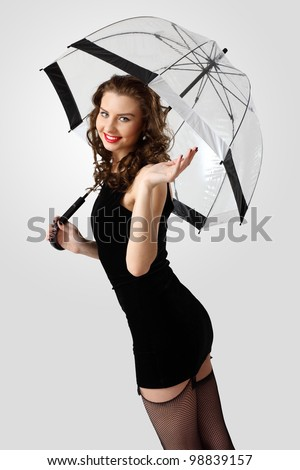 Young prestty woman dressed in retro style with umbrella