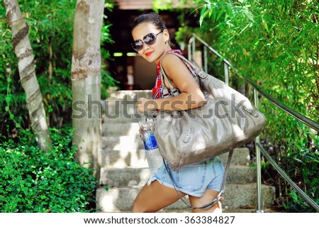 Young pretty cheerful girl with a bag