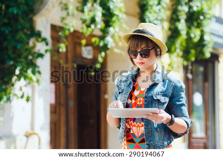 Smiling fashionable blonde drinking cola outdoors stock photo young pretty woman tourist using tablet travel app guidebook ebook on in the old european city fandeluxe Ebook collections