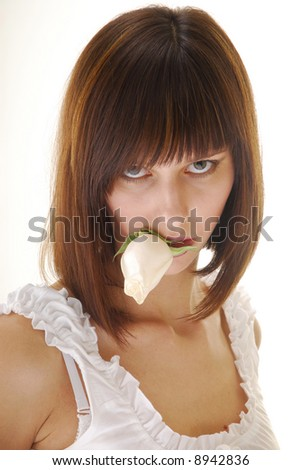 Young pretty woman with white rose in her lips