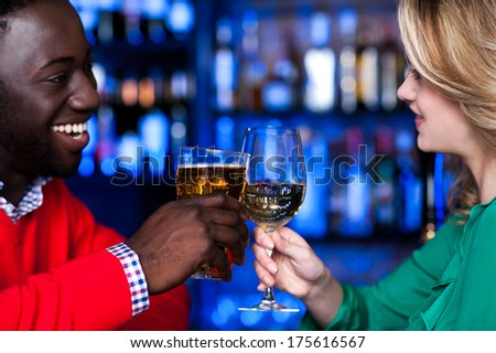 Young romantic couple enjoying cocktails in nightclub