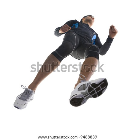 Young running athlete. Wearing tight-fitting uniform. Low angle view