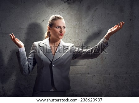Young saint businesswoman praying with hands on chest