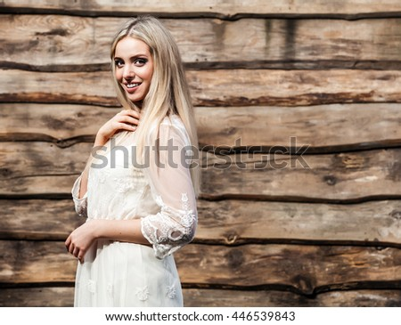 Young sensual & beauty woman pose on grunge wooden background.