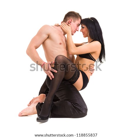 Young sexy couple isolated on white background