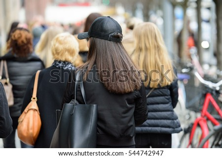Young shopping women on crowded street