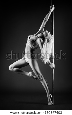 Young slim pole dance woman.