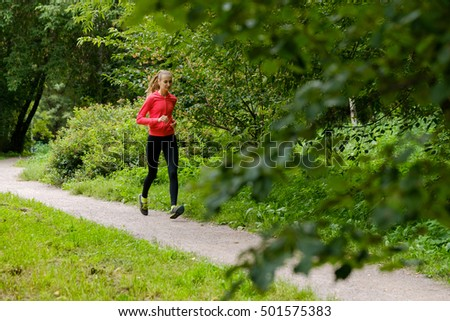 Young slim woman jogging in a park