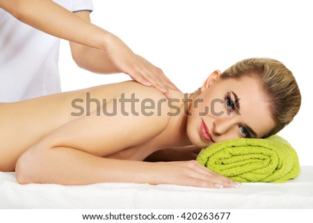 Young smile woman lying on a massage table and has massage.