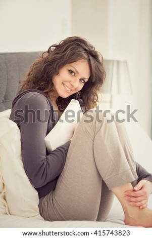 young smiling brunette girl relax in her bedroom
