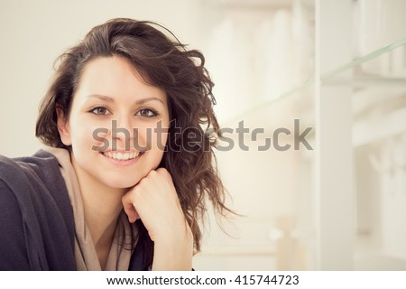 young smiling brunette woman in the kitchen
