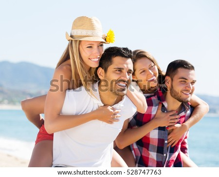 Young smiling couples in love on romantic summer holidays vacation
