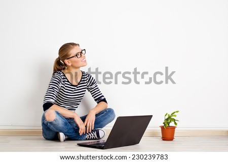 young smiling woman dreaming of new home decor and furniture pretty caucasian female sitting with