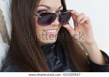 young smiling woman in sunglasses outdoor