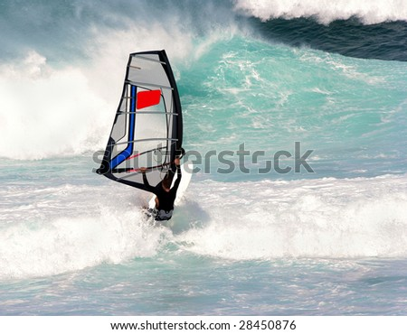 Young solo windsurfer battles ocean waves