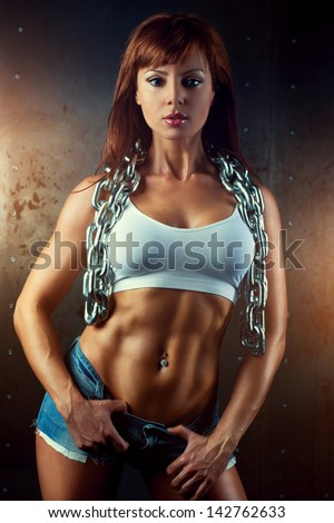 Young sports woman with heavy chain.