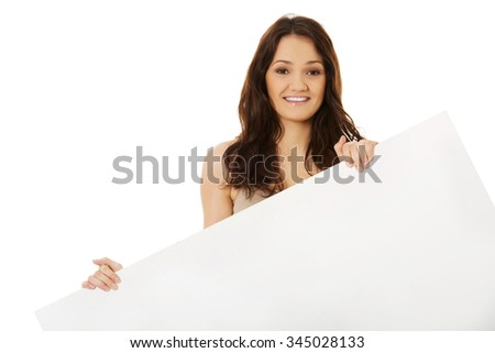 Young student woman with empty banner.
