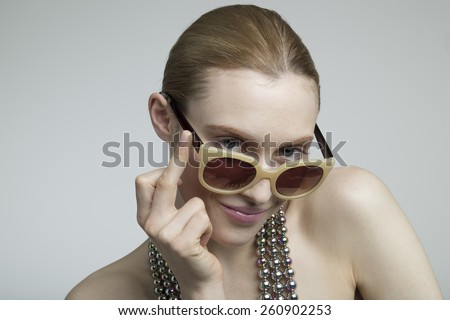 young stylish caucasian woman in sunglasses