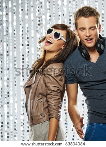 Young stylish couple in the nightclub