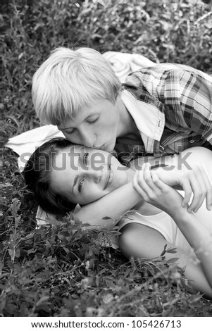 Young teenage couple in park. Photo in black and white style.