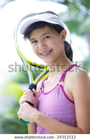Young teenage girl ready for game of tennis