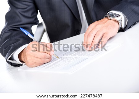 Young unemployed man is writing summary. He is looking for a job.