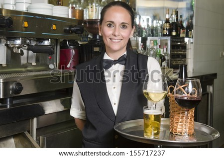 Young Waitress serving beer wine bar tray