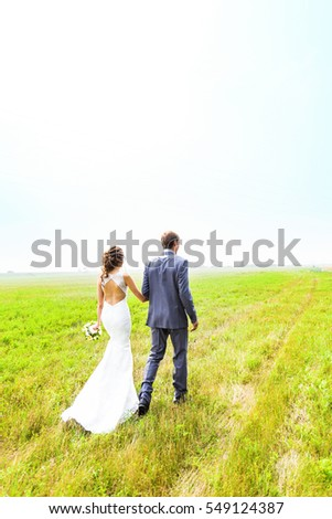 young wedding couple, beautiful bride with groom portrait, summer nature outdoor