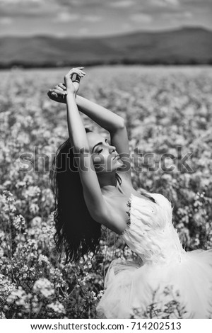 stock photo young wedding sexy girl woman with brunette hair and pretty face in white bride dress in field with 714202513