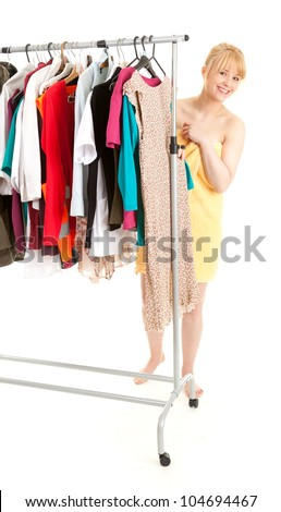 young woman after shower choosing clothes in her own dressing room, white background
