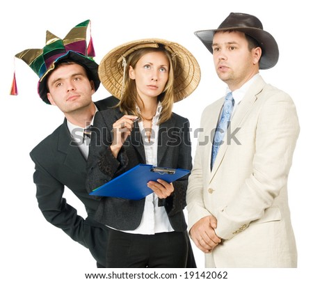 Young woman and two man in hats of clown, asian peasant and cowboy. Isolated on white.