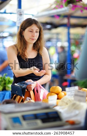 Young woman at the farmer market