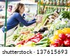Young woman at the market - stock photo