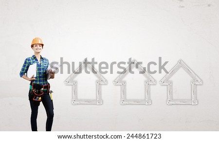 Young woman builder with projects in hand