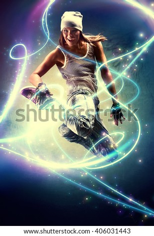 Young woman dancer. With lights traces and sparks effects.