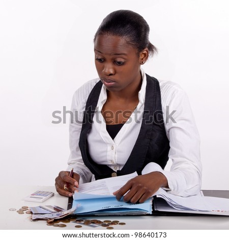 Young woman doing her budget and tired of it, or just worried about her finances!