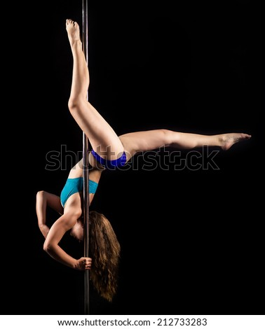 Young woman doing pole dance