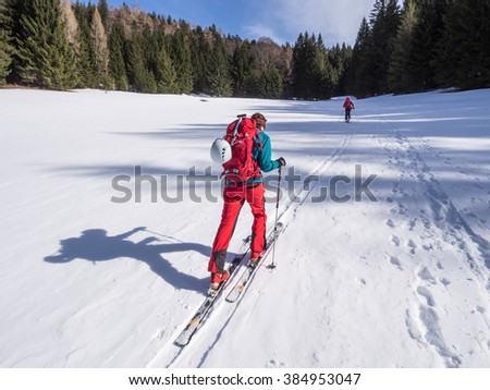 Young woman doing ski touring winter activity