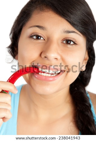 young woman eating red chili pepper