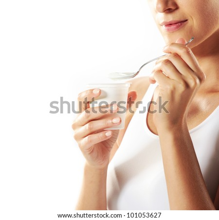 Young woman eating yogurt , close up