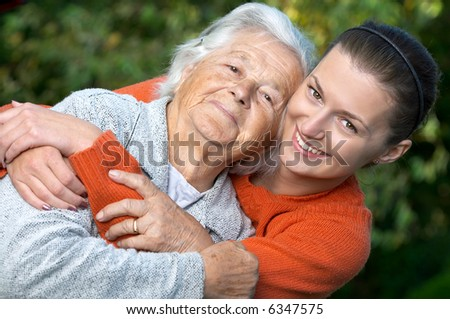 Young woman embracing her grandmother