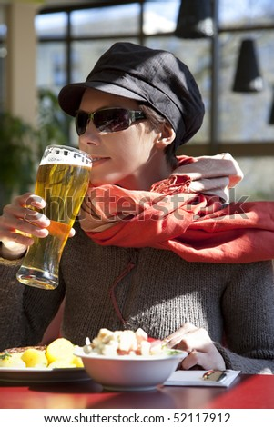 Young woman enjoying a glass of beer