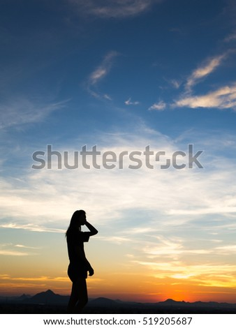 Young woman enjoying outdoors, sky background,sunset