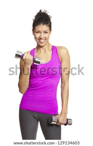 ... in sports outfit holding dumbbells on white background - stock photo
